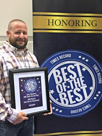 Jeremy Lensing, service manager and his department's Best of the Best award.